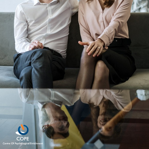 couple sitting on a couch for couples therapy