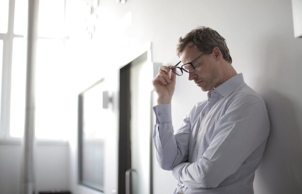 man suffering from burnout